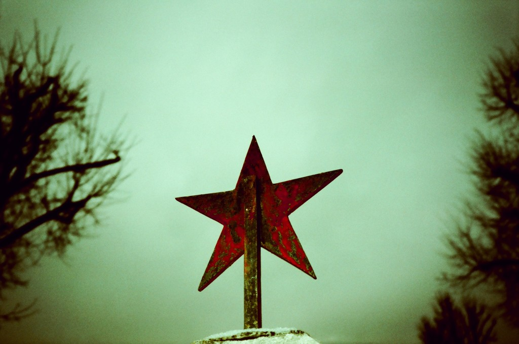 A red star sits on top of the grave of a Soviet soldier. Malacky, Slovakia, 2014