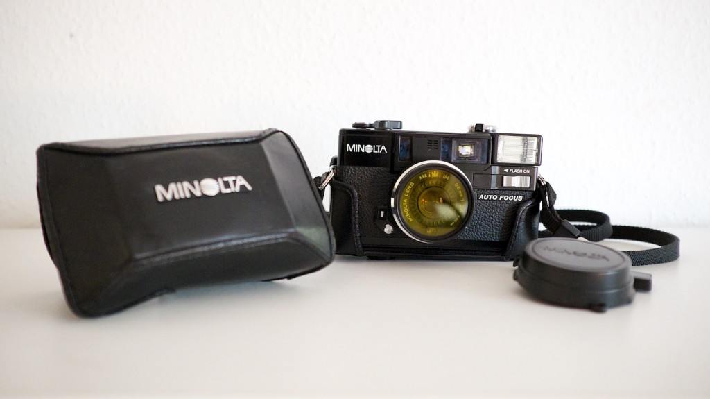 With bag and lens cap which doubles as a shutter button lock.