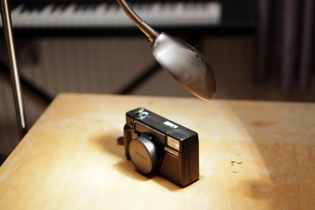 A Nikon L35AF warming up under a halogen light