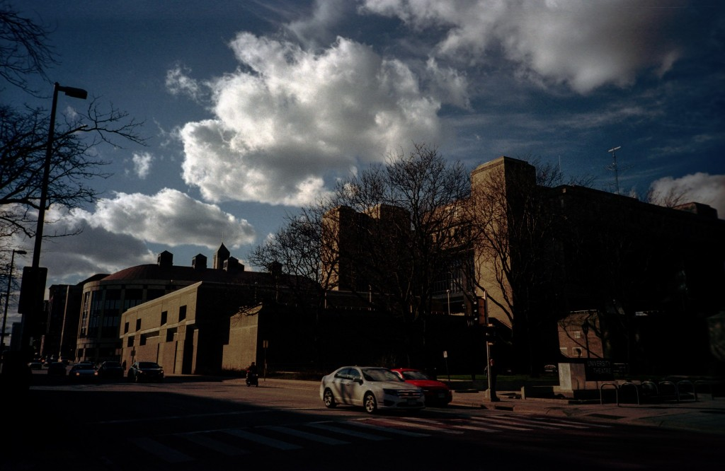 Photo of a building and cars on Johnson Street in Madison,WI.