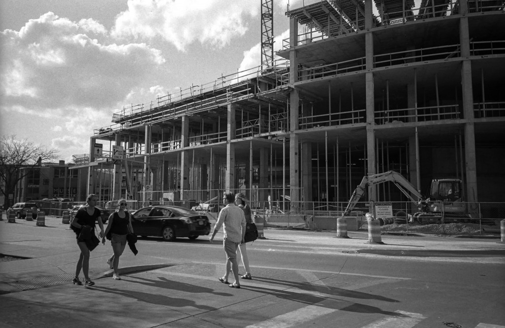 Photo of people and construction on University Avenue in Madison,WI.