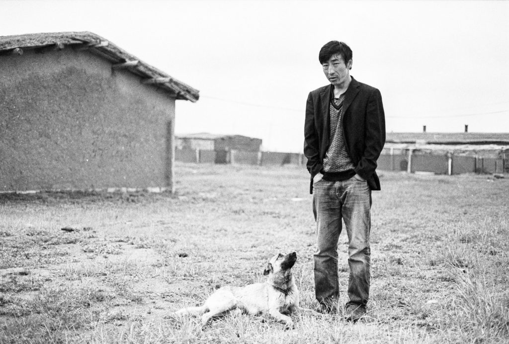Man with dog in Mongolia