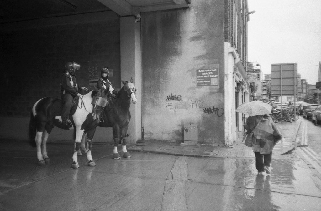 Photo of Police officers on horses made with Canon Sure Shot Sleek camera