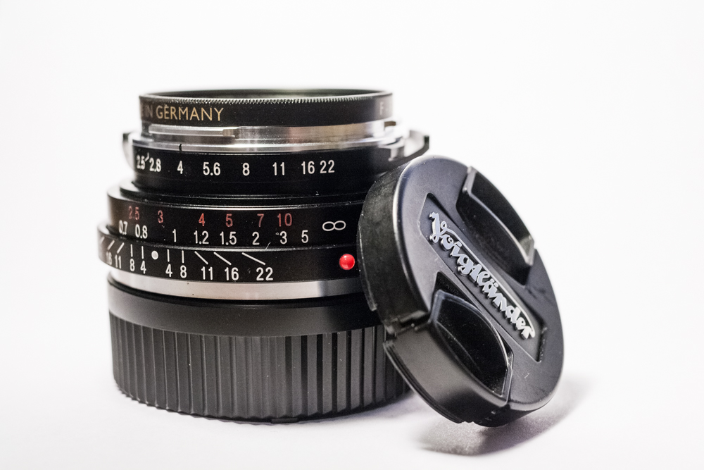 Lens and cap
