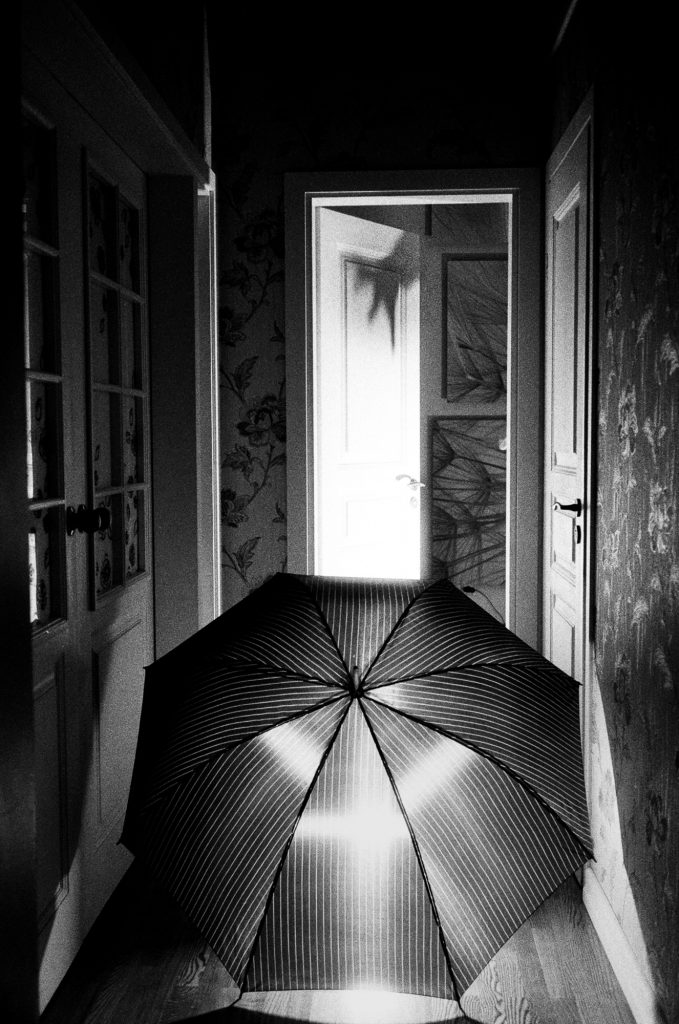 open door and umbrella at night