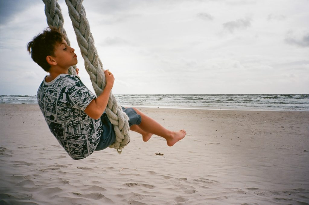 boy in rope swing on beach Contax T2 Kodak Ektar 100