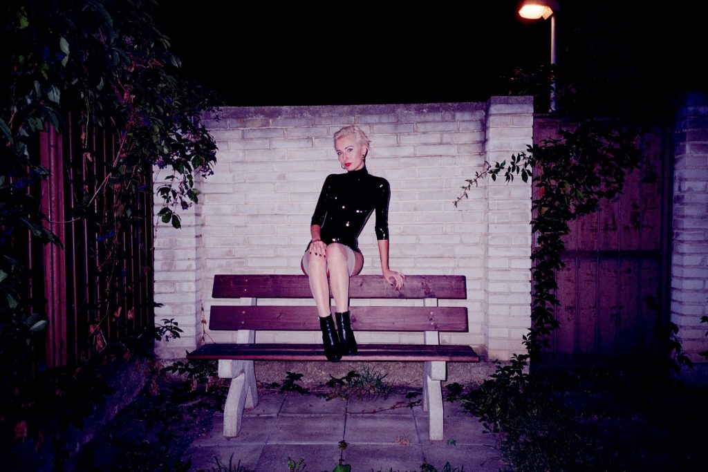Portrait of young woman sitting on bench made with the Minolta TC-1