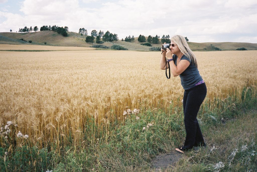 "Manual Zoom - Portra 400, Eve leaning in to zoom her fixed lens X100s 6"" closer for the perfect landscape shot."