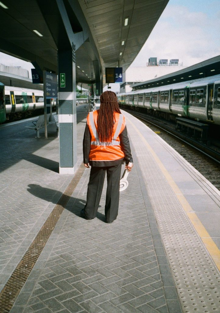 Photo of woman at train station with Olympus Pen EE2