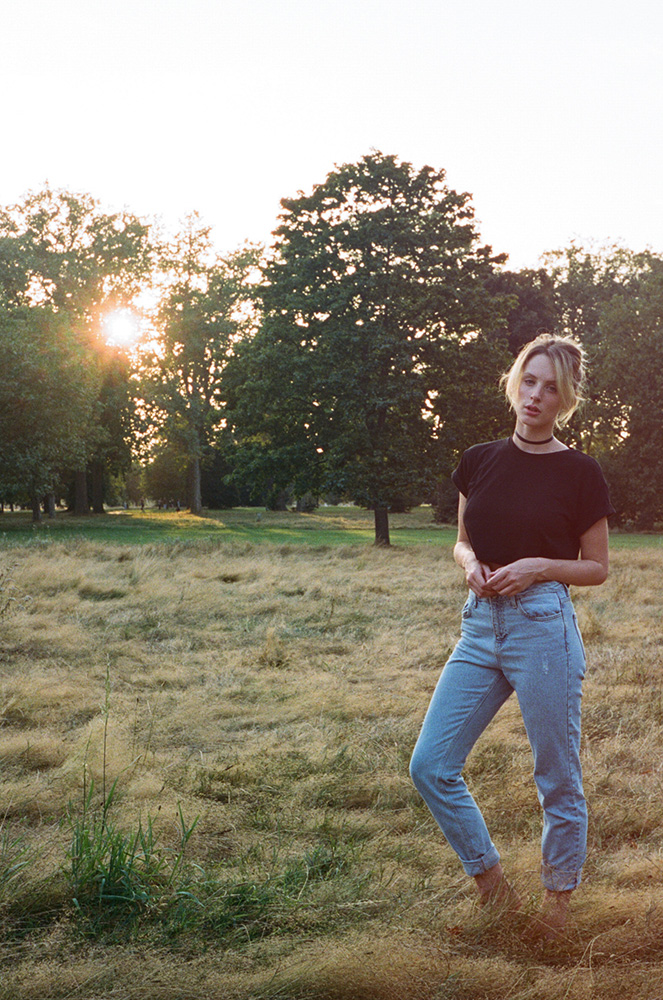 Portrait of woman standing in field photographed with Contax T2