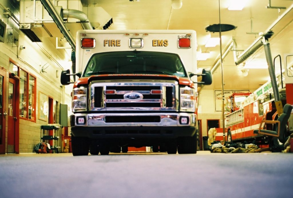 Image of ab American Ford fire truck in its garage.