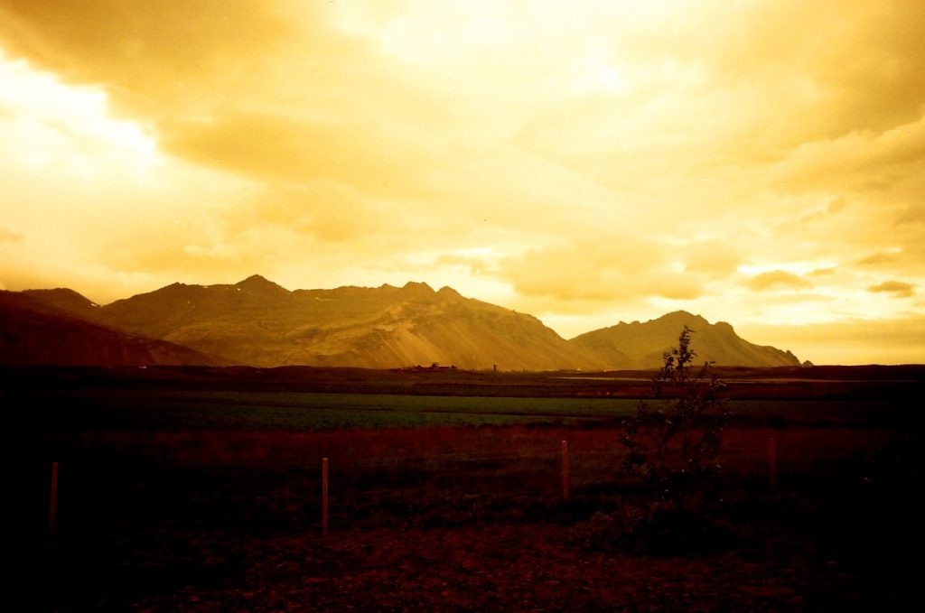 Icelandic flatlands leading to volcanoes. Five frames with a Canon AT-1 and a roll of Redscale.