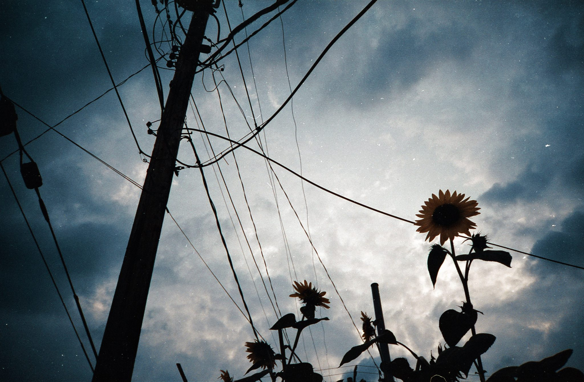 The Yashica Ninja Star II AF-J2 photo of clouds and power lines