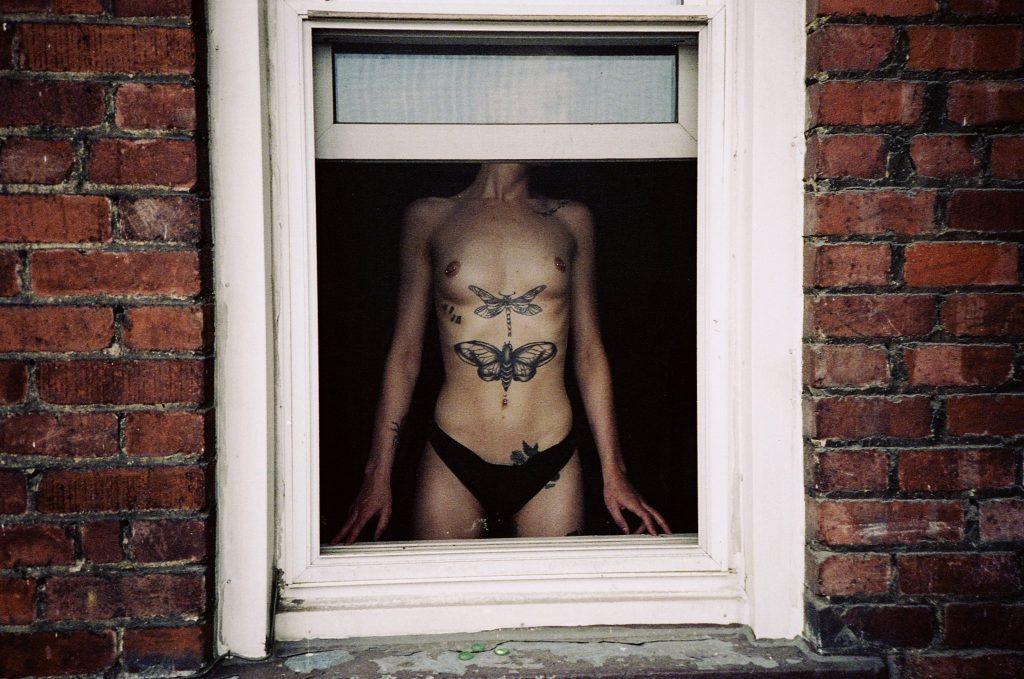 Photo of nude woman in window with the Yashica Ninja Star II AF-J2