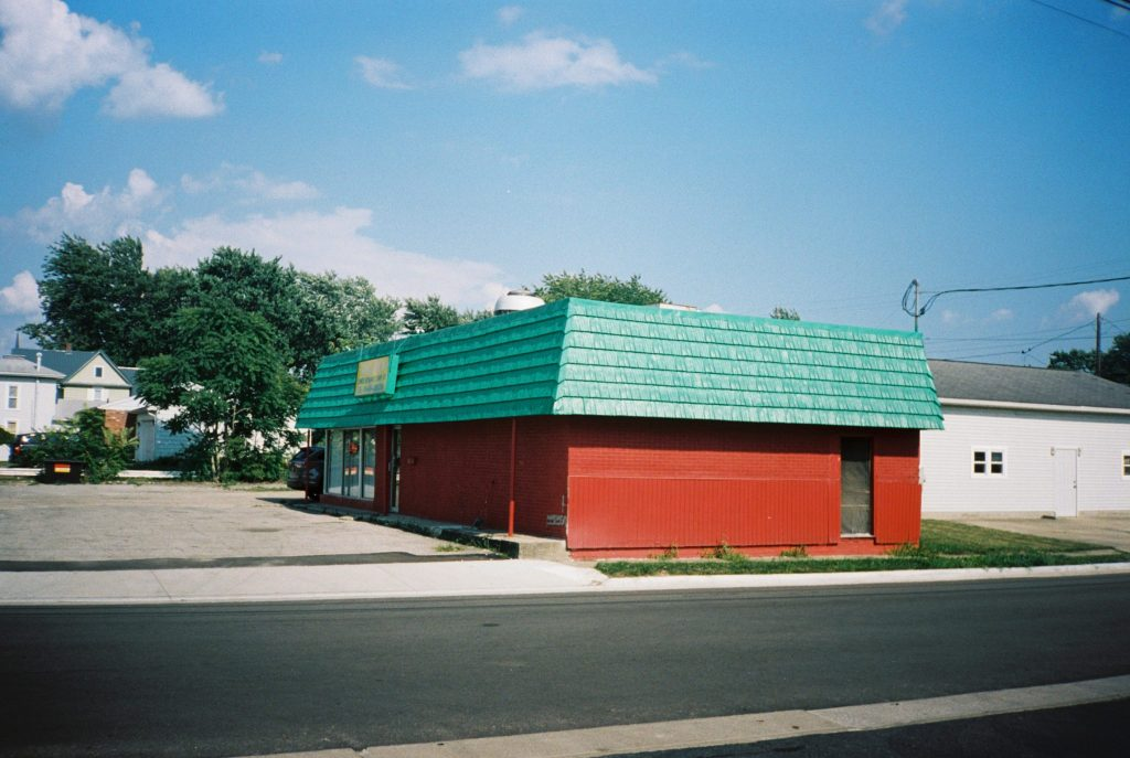 Minolta AF 35R QD photo of red building with green roof