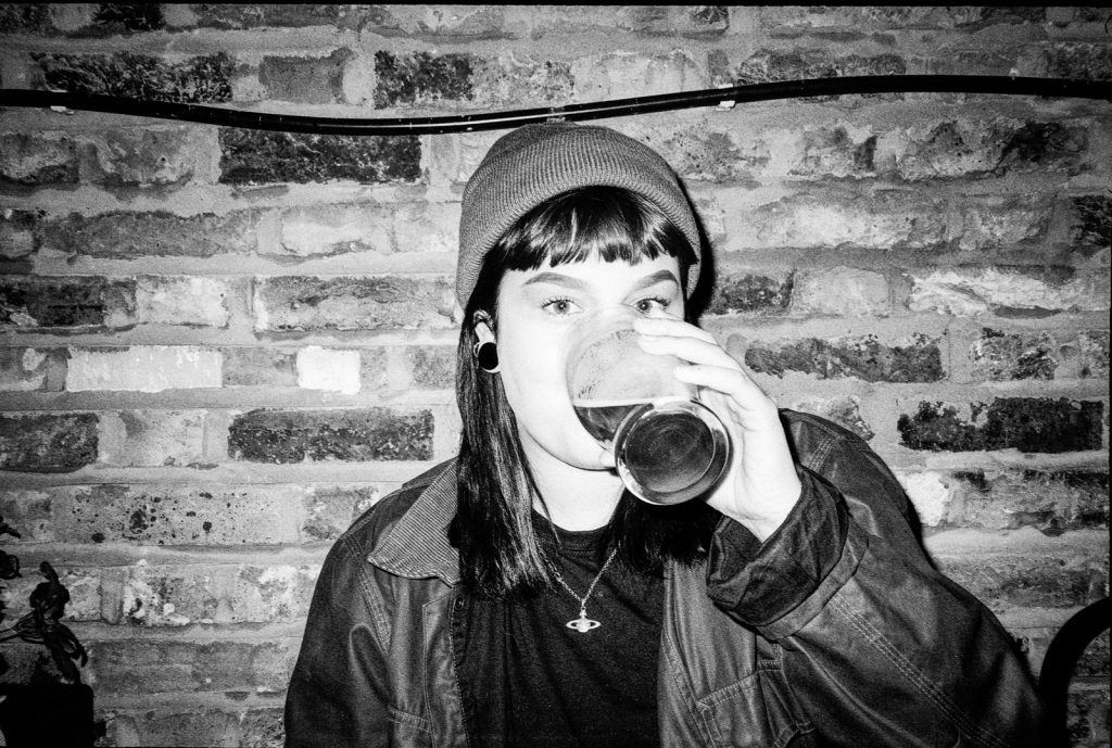 Canon SureShot Autoboy AF35MII photo of woman drinking pint