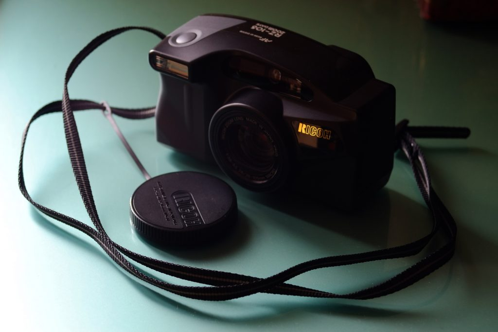 Ricoh RZ-105 Zoom Date with black neck strap