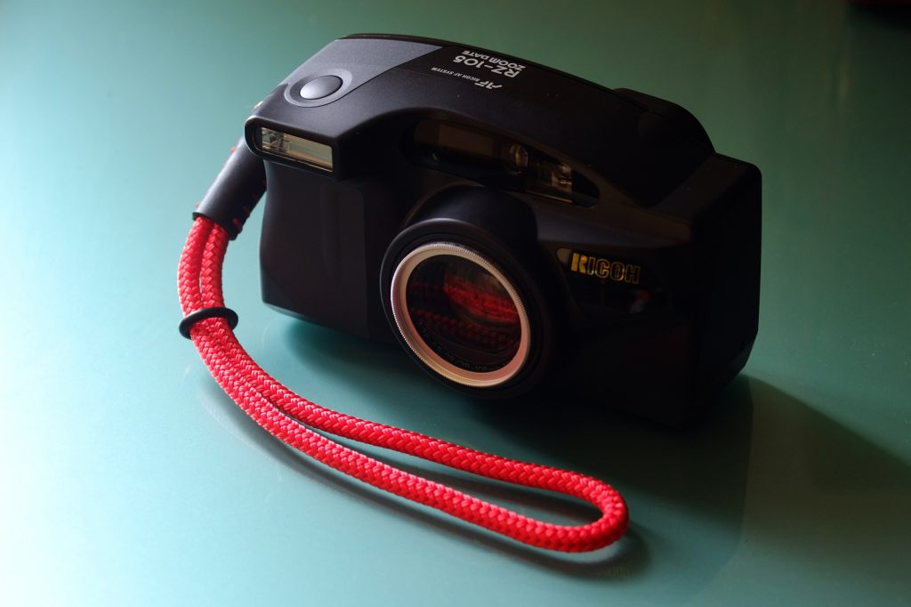 Ricoh RZ-105 Zoom Date with red wrist strap