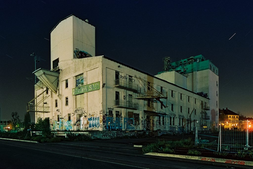 abandoned silo building shot at night on CineStill film
