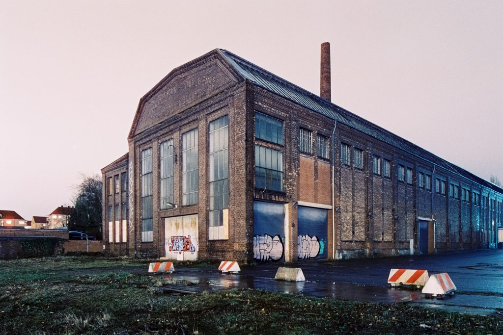 Abandoned ironworks building shot at night on CineStill film