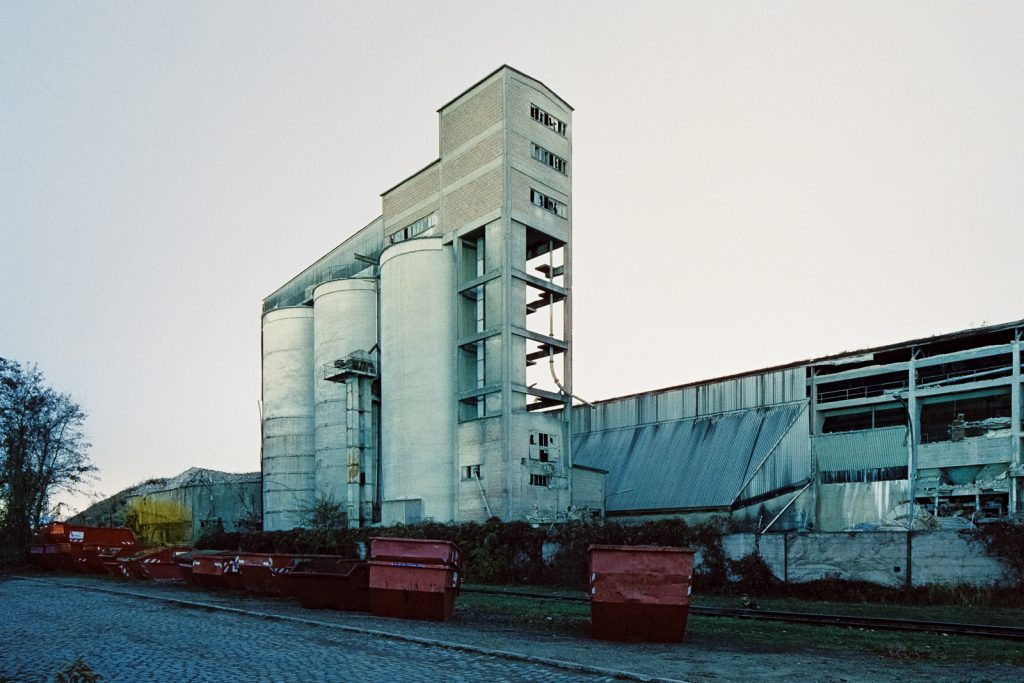 abandoned cement works building shot at night on CineStill film
