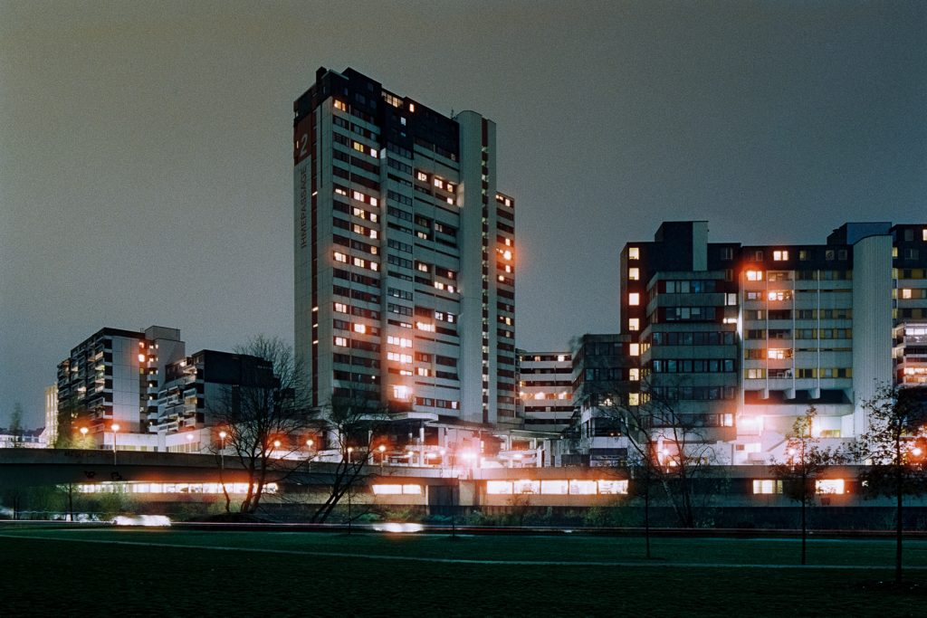 "high-rises of ""Ihme-Zentrum"" housing complex in Hanover, shot at night on CineStill film"