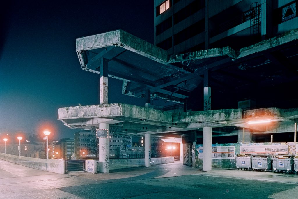 "demolished facade of ""Ihme-Zentrum"" housing complex in Hanover, shot at night on CineStill film"