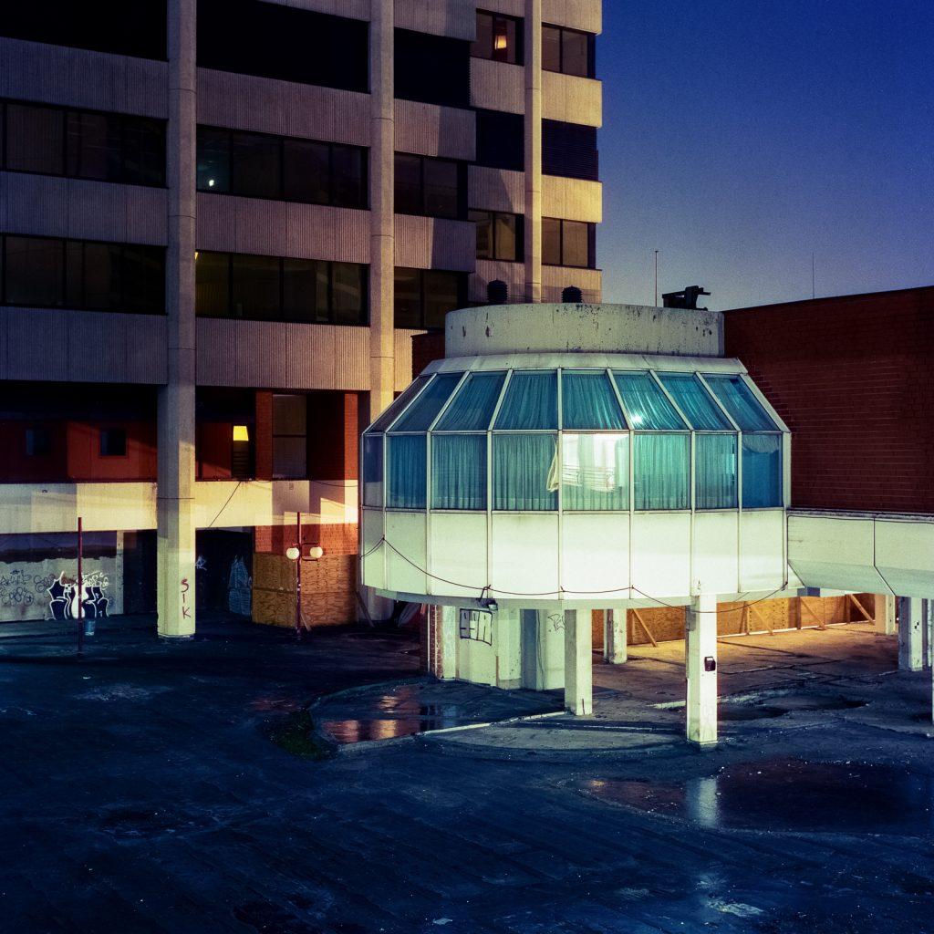 "inner yard of ""Ihme-Zentrum"" housing complex in Hanover, shot at night on CineStill film"