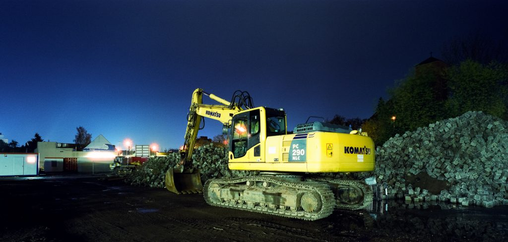 yellow excavator shot at night on CineStill film