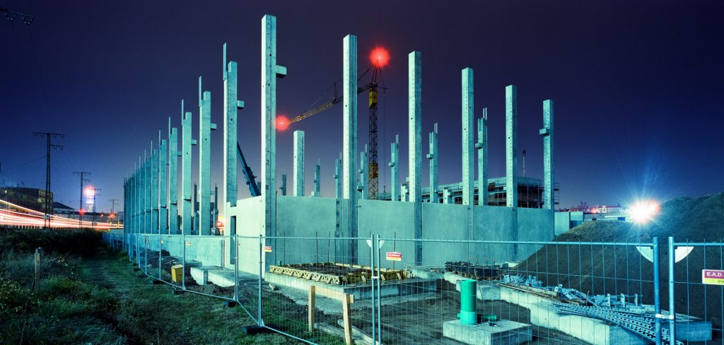 shell construction of a warehouse shot at night on CineStill film