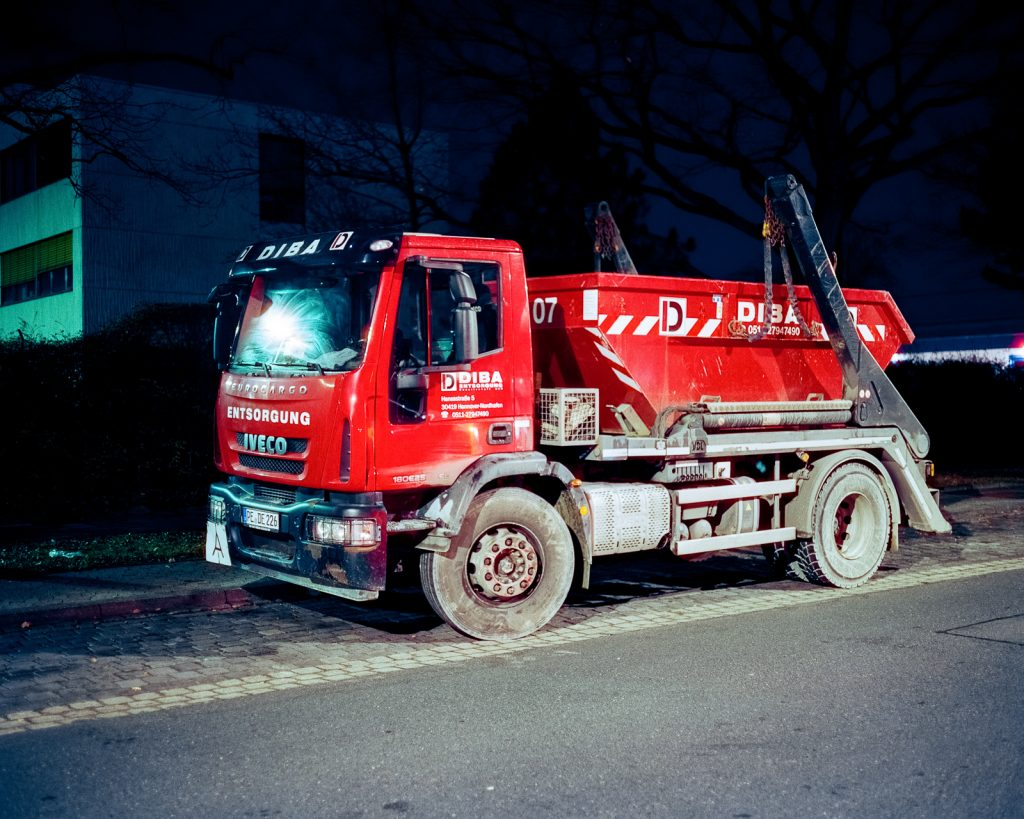 red dumpster truck shot at night on CineStill film