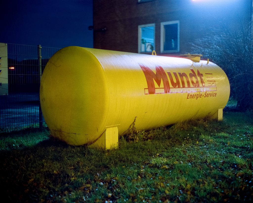 yellow fuel tank shot at night on CineStill film