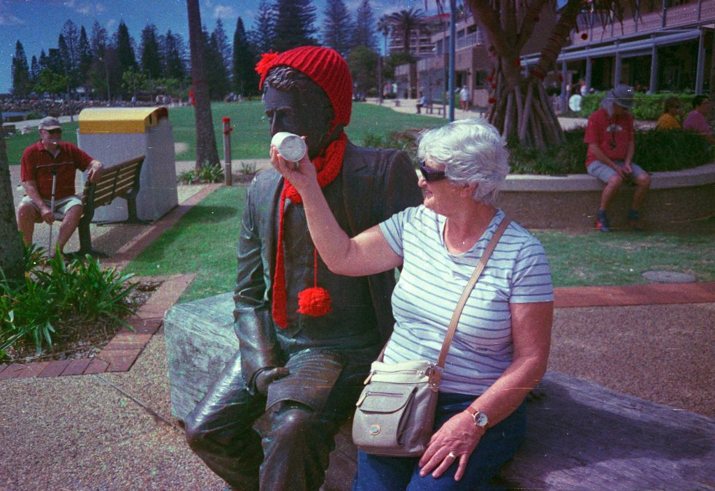 Woman and statue photographed with National (Panasonic) C-500AF