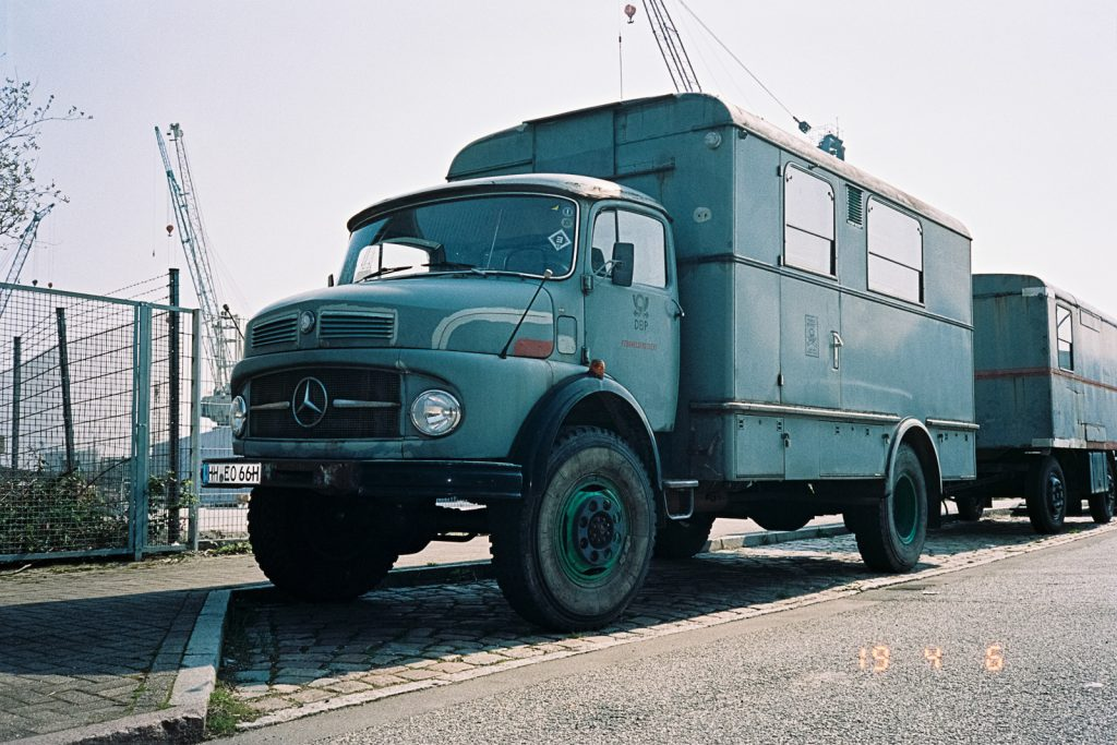 An old grey truck built by Mercedes-Benz.