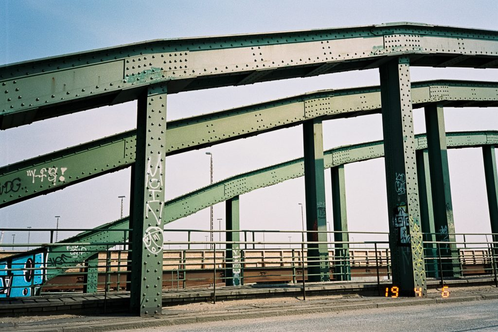 Three arches of a brigde made of steel.