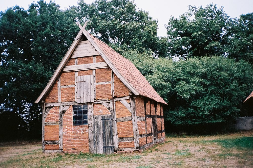 A small barn-like building made of bricks and wood.