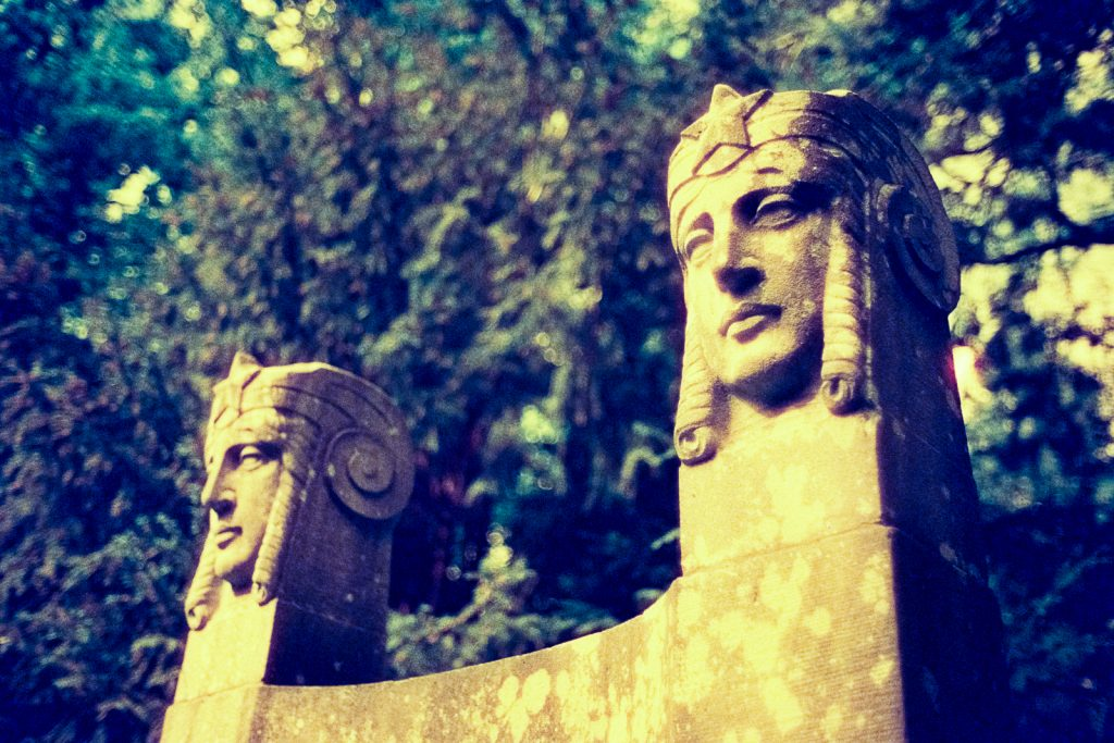 tombstone at the Engesohde cemetery in Hannover, shot on CineStill 800t film with an orange filter