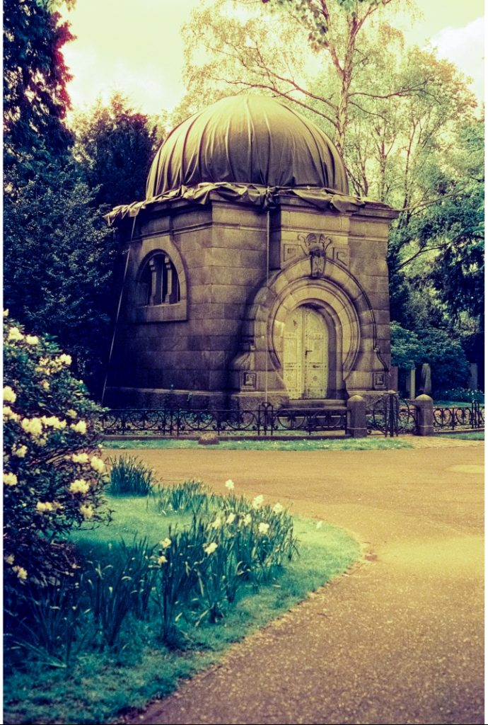 mausoleum at the Engesohde cemetery in Hannover, shot on CineStill 800t film with an orange filter