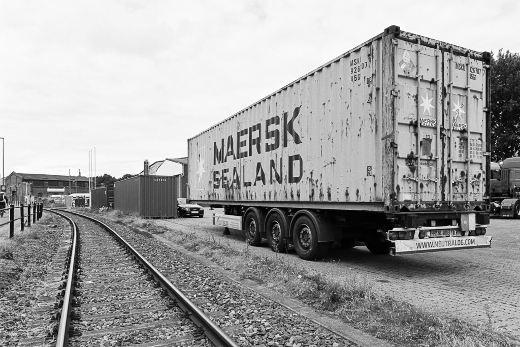 Rusty 40 foot container parked at Bremen ports, shot on Fuji Acros black-and-white film.