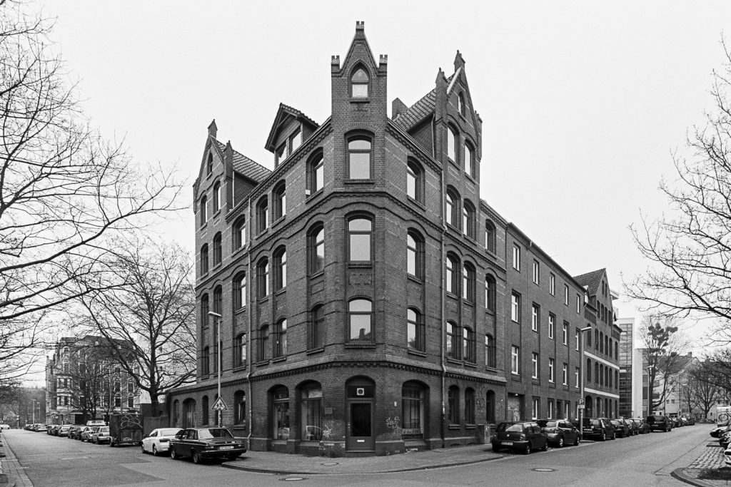 Black-and-white photograph of a Gründerzeit house located in Linden quarter of Hannover, Germany.