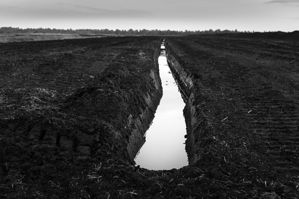 An endless ditch cuts through the peat bog.