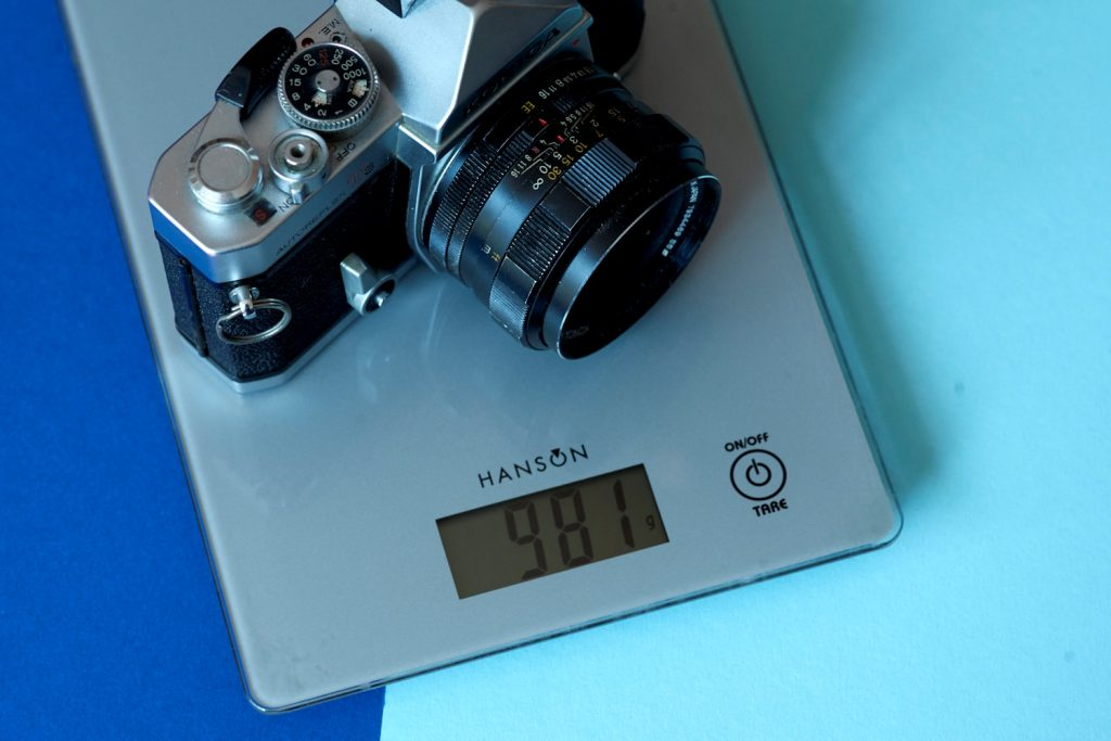 Original Autoreflex T3 on scales to show weight (981g)