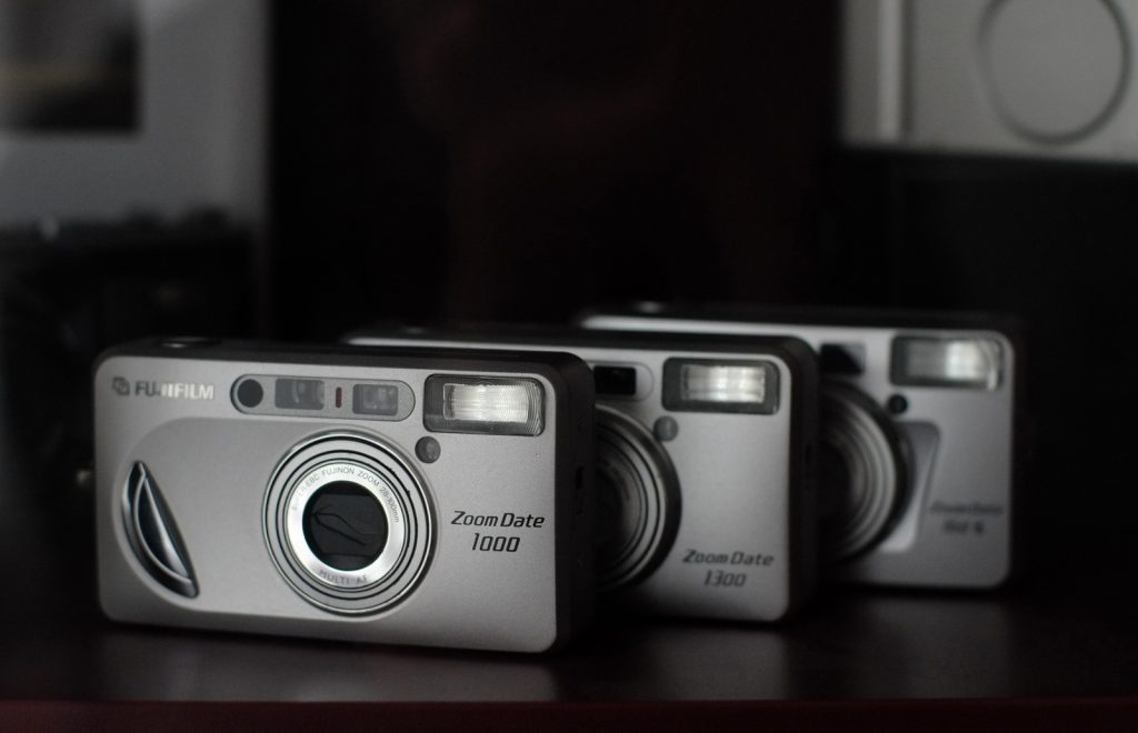 Three Fujifilm Zoom Date cameras