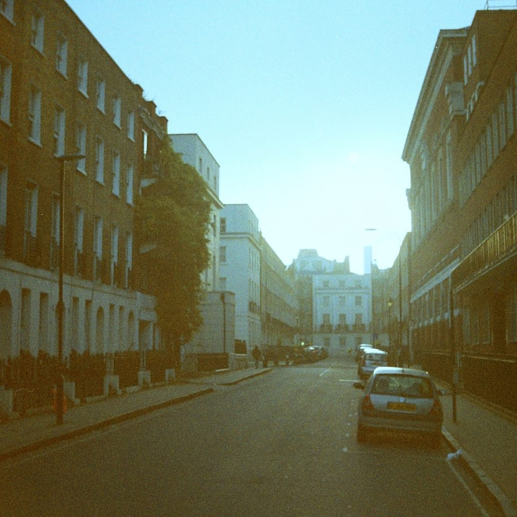 empty London street with sun appearing