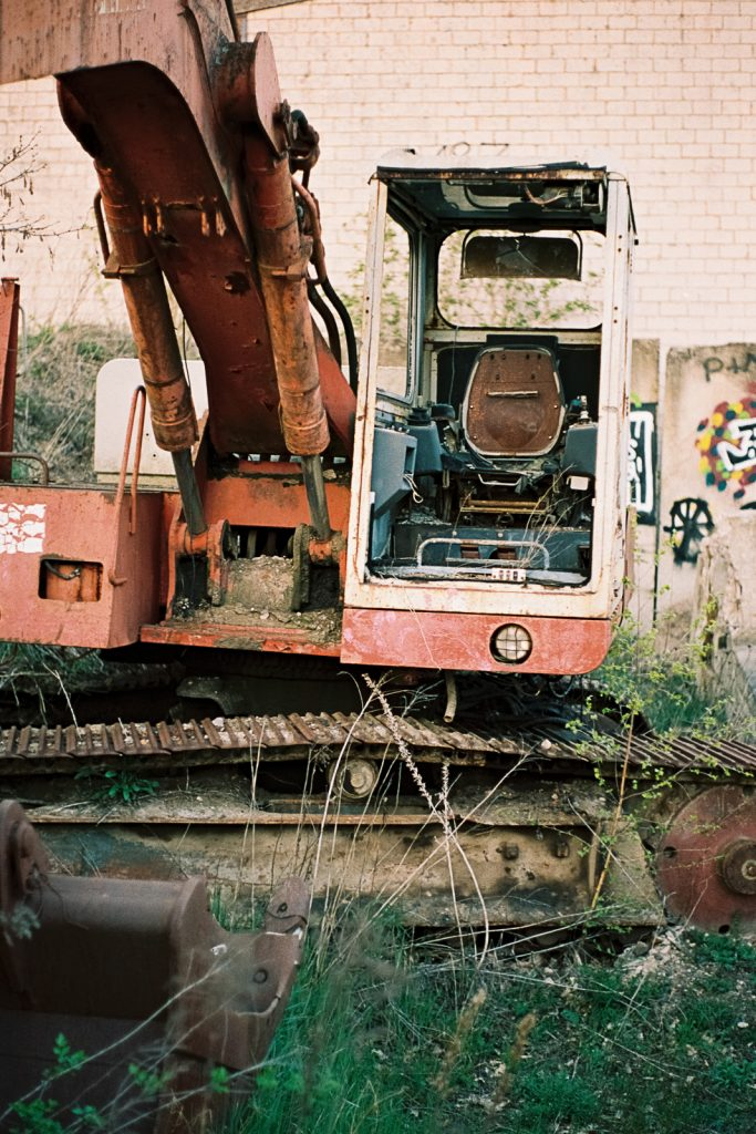 Abandoned and heavily damaged excavator.
