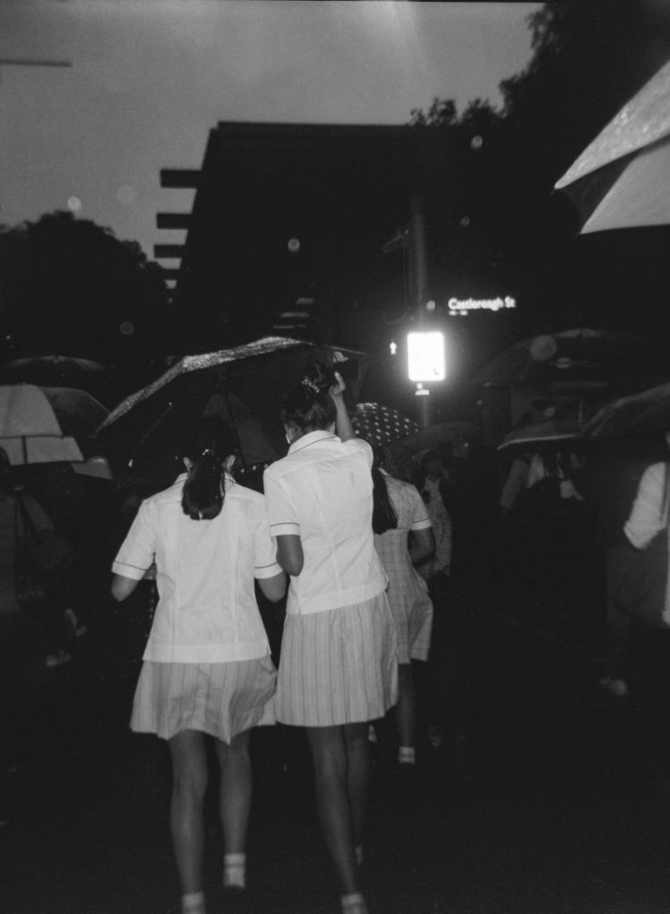 School girls with umbrella