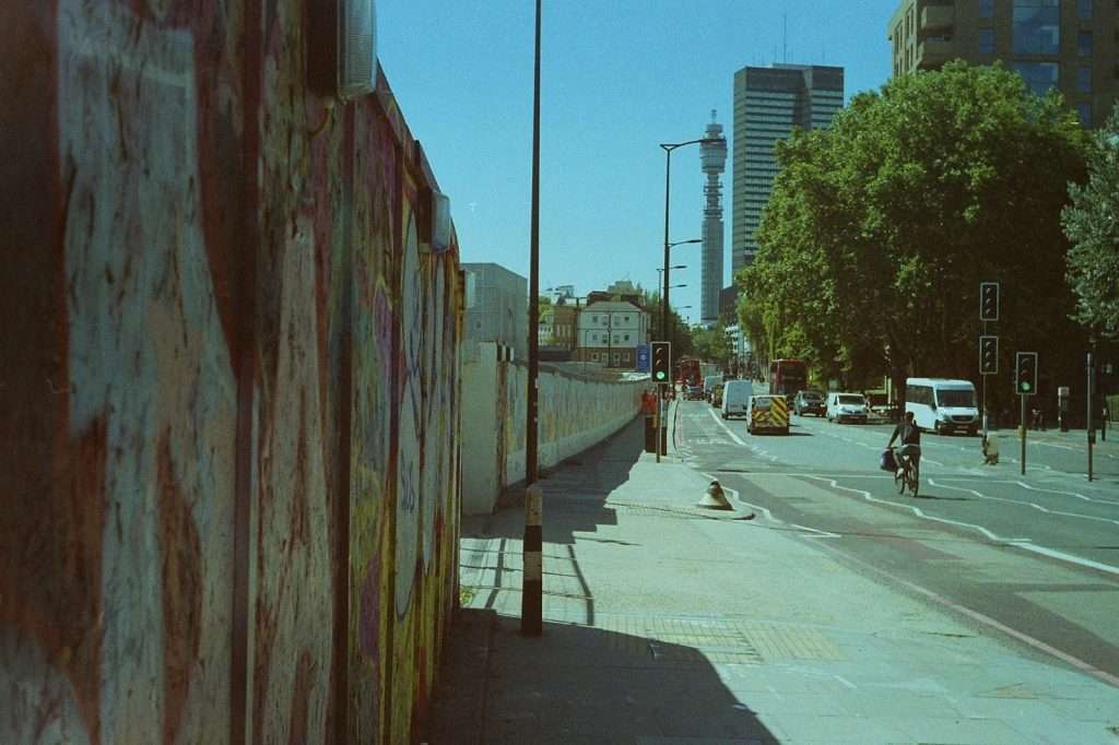 photo of london road with graffiti, bt tower and euston tower