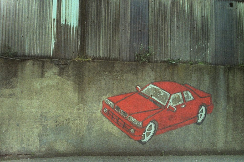 photo of a red car painted on a wall