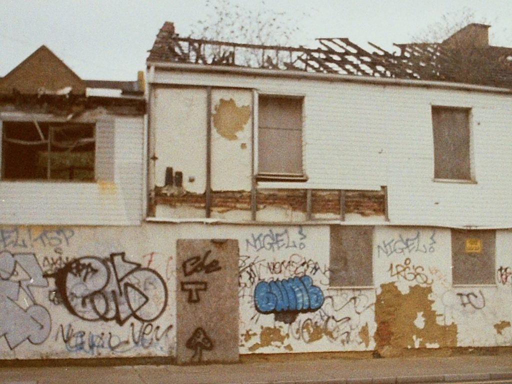 shell of house with graffiti