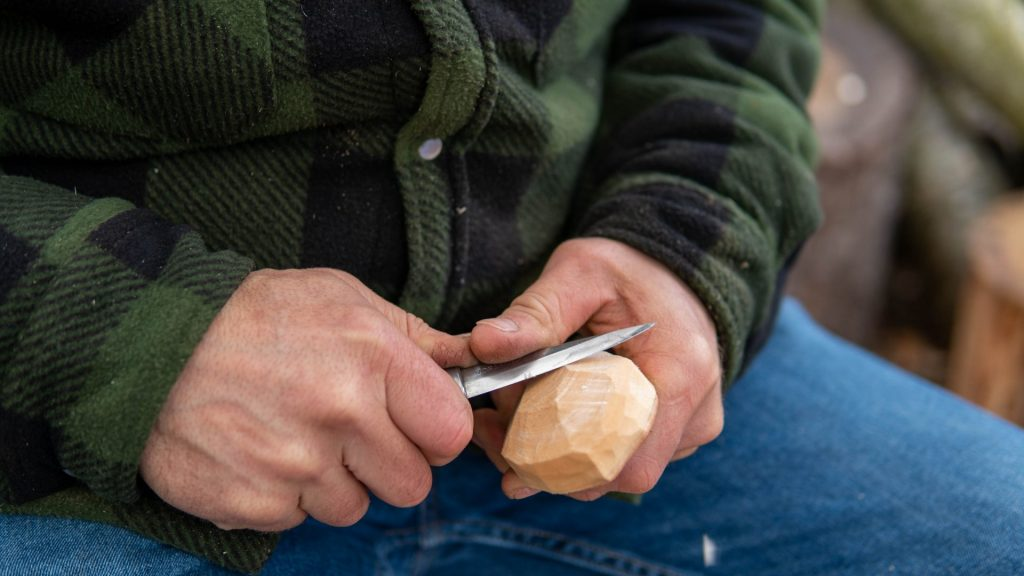 Carving a greenwood spoon with knife